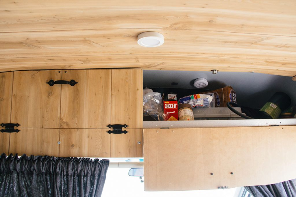 Overhead storage is where we keep food supplies and jackets.
